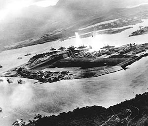 Captured Japanese photograph of attack on Pearl Harbor 7 December 1941.  Looking from west to east across Ford Field.  Note explosion from airplane departing over battleship row.  (US Navy photo)
