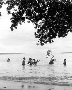 Swimmers enjoy the waters of Palikula Bay, Espiritu Santo, New Hebrides during the 1942 campaign for Guadalcanal.   USS Dale was the first destroyer to visit this island, and her sailors were  among those modeled by James Michener for his Tales of the South Pacific.