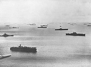 Task Force 58 carriers, battleships, cruisers and destroyers at rest at Majuro Atoll after raids throughout the Central Pacific in February 1944.  (US Navy photograph)